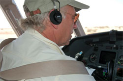 Jimmy Buffett flying his Falcon 900